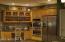 Kitchen double oven and wine racks