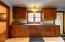 This is no ordinary kitchen! Owner has taken much pride in these custom quarter sawn red oak cabinets and woodwork!
