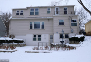 Large 4 bedroom 3 bath home towers over spacious back yard.