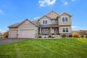 Slate stone, cedar shakes and accent landscaping give this home fantastic curb appeal.