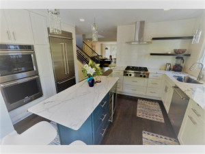 Chef's dream kitchen! Updates galore. Custom cabinetry, marble countertops, refinished hardwood floors, high-end appliances, wine fridge, and the list goes on!