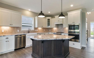 Gorgeous kitchen layout! *Note, photo is not of actual home but a similar floor plan some colors, upgrades and features will vary.