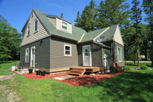 Fantastic 1.5 story with newer siding & roof and tons of character