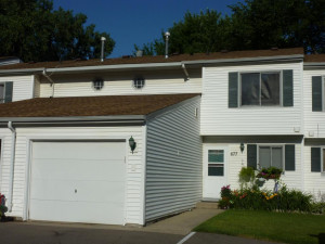 Attached Garage with 2 parking spaces in front