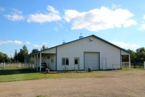 The barn has 5 total box stalls one of which is over sized, a tack room, a feed room and an all weather faucet.