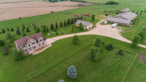 8374 County 6 Road SW - 40 Acres, heated Horse Barn with Indoor Arena & 8 box stalls, huge pole shed/shop and outdoor kennel building.