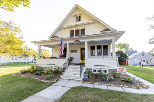 Beautiful front porch and tons of architectural details on this beautiful home.