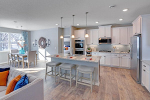 Thoughtfully-designed, modern and fresh describes this kitchen. Equipped with stainless steel appliances, granite countertops and a large island, this kitchen adds distinction and character to the home. *Photo of model, selections may vary