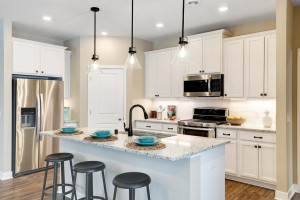 Thoughtfully-designed, modern and fresh describes this kitchen. Equipped with stainless steel appliances, granite countertops and a large island, this kitchen adds distinction and character to the home. (Photo of model, colors may vary)