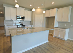 Thoughtfully-designed, modern and fresh describes this kitchen. Equipped with stainless steel appliances, granite countertops and a large island, this kitchen adds distinction and character to the home. (Photo of same plan, colors may vary)