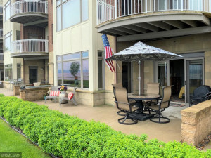 Welcome to unit 102, a gorgeous patio level condo! Plenty of space to entertain family & friends.