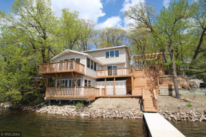 Gather in this inviting home, entertain and relax in this spacious completely rebuilt year-round home on the water's edge.