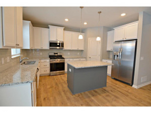 Stainless steel appliances accent this wall-to-wall kitchen layout. *Pictures are of a model home, finishes and colors in actual home may vary.