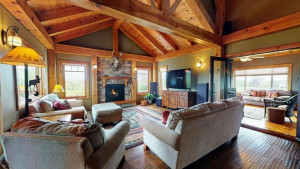 Beautiful pinned post and beam construction with spacious vaulted ceilings. Gorgeous fireplace with wonderful outside view into the valley.