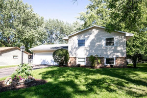 Mature trees and a low maintenance exterior await you here. Newer garage door and opener provide access to the attached garage.