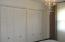 large closets/louvered doors in 2nd bedroom