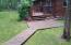 Wooded walkway from garage to home