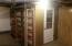 Basement with shelves and storage