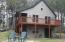 view of 2 sided wood deck and walkout basement