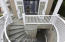 Stairwell leading to play room/man cave/bar/basement