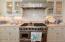 Limestone countertops and tile backsplash