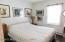 Bright bedroom with hardwood flooring