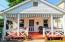 Inviting, open and spacious front porch welcomes you into this charming home...