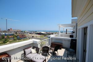 You don't get much closer to the action than this! Beautiful 4 story townhome with stunning ocean views only a short block to the beach! Almost 2300 square feet of living space with a 2 car garage (you can also purchase a street parking permit for $90 every year). 5 outdoor spaces, a patio, 3 balconies and a large roof top deck WITH GAS BBQ hookup!! Less than 4 years old.. Kitchen w/42'' cabinets, granite and SS appliances. 2 zone/HVAC.. Listen to the Stone Pony Summer Stage concerts or watch the spectacular July 4th fireworks right from your rooftop deck!.. Located in the ''epicenter'' of Red Hot Asbury right between the thriving downtown district and the beach front with over 40 restaurants/bars/entertainment venues within walking distance.. ..