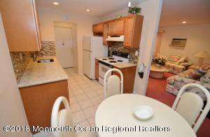 Updated kitchen with granite counters, tile flooring, recessed lighting and ceiling fan