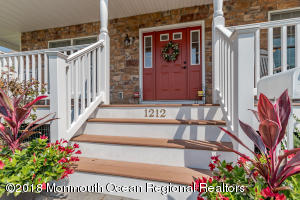 Welcome and enjoy this wraparound porch to the enclosed sun porch in rear of home.1.5 mile from beach.