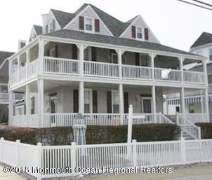 Enjoy the Fall, Winter, Spring and Summer in this magnificent Victorian home with 2 wrap around porches. This historic home was built in 1883 on the South End of Point Pleasant Beach.  It was one of two connected homes that were part of the original Lands End Hotel that closed it's doors on or around 1963.  Your family can soak in the ocean breezes and views while living just a block and a half from the boardwalk and beach.  This house is perfect as a mother daughter unit; as a live in one unit and rent the other unit;  great for a Summer rental or an all year round rental;  or an entertainment home for friends & family.  This fully furnished legal two Family home is just waiting for  your family to enjoyed the comforts of living at the beach. Come live the good life.