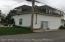 Back view of large 3 bedroom back cottage home on oversized lot