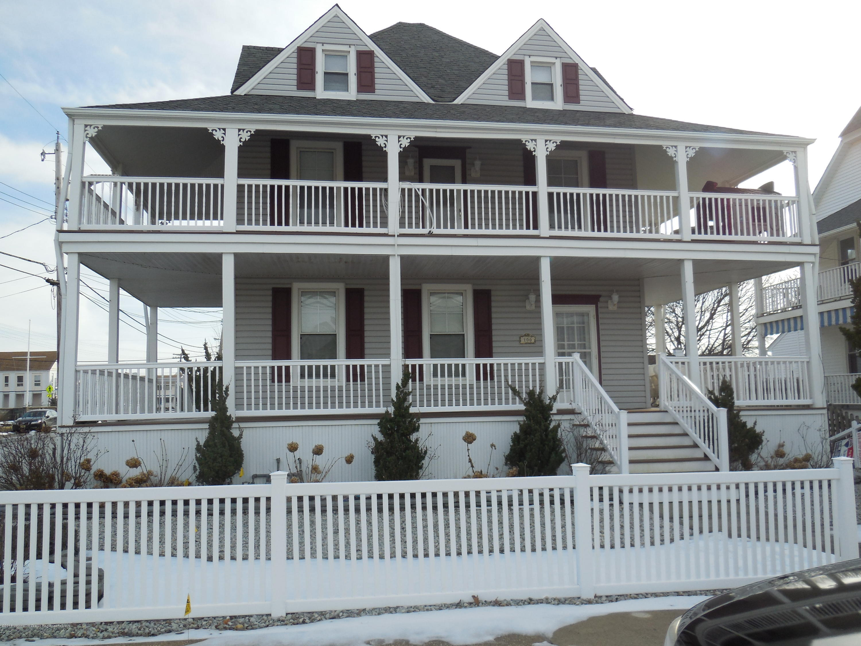 Enjoy the Winter, Spring, Summer and Fall in this magnificent Victorian with 2 wrap-around porches.  This home is only 2 short blocks to the boardwalk & beach.  Soak in the ocean views and breezes from the open porches.  A total of 5 bedrooms, 4 have queen beds.  The 5th bedroom has twin beds.  There is a full size futon in the third floor living room.  In all the home sleeps 12.  There are living rooms on each of the 3 levels.  There are full bathrooms on all levels. A tub/shower on level 1 and stall showers on levels 2 & 3.  The first & second floors  have fully equip kitchens with dining areas plus washers & dryers which makes it perfect for extended families & friends.  Rental prices vary seasonally. Short term rentals are preferred.  Listing price is the 2019's Summer rate per week.