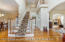 Open two story entryway with grand staircase