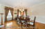 Formal dining room with chair rail and crown molding