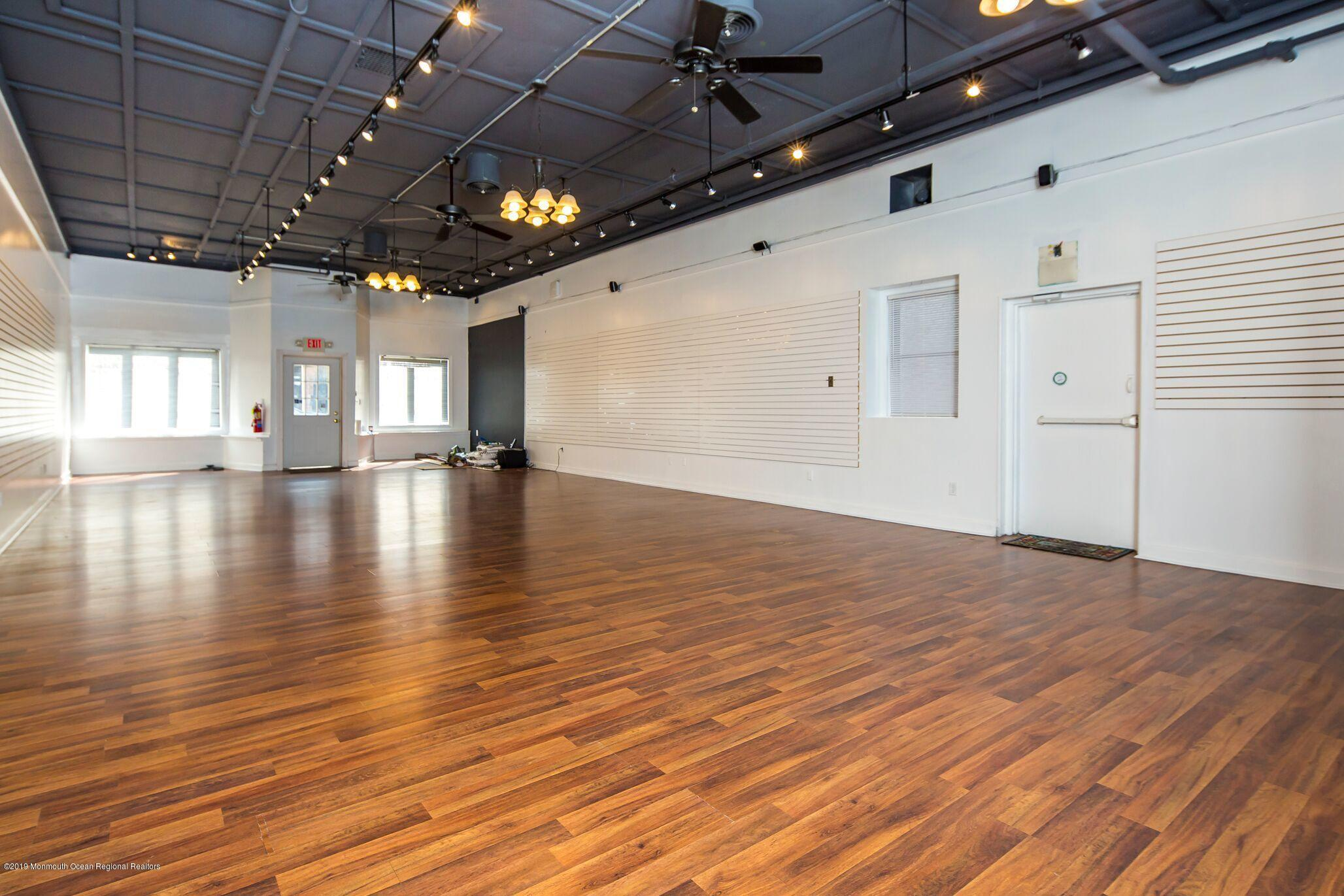 Amazing 1200 sf retail or office space with new floors, high ceilings and uber cool vibe.  Not only does it have 2 baths and a conference room area, but it has a shower and parking!  This will not last, come see it for yourself.