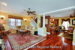 1st floor. 9 ft ceilings. Mahogany floors throughout all 3 levels. Gorgeous!