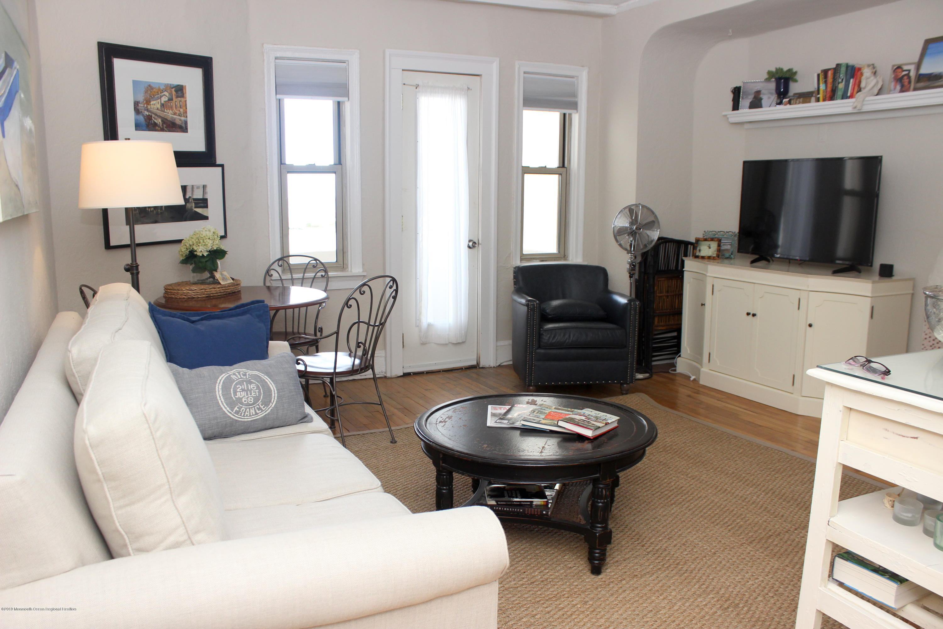 Life really is better at the shore! Move into this large 1BR condo in the historic pet-friendly Santander and you'll be just a couple of short blocks to the sand and the sea. This coveted ''L'' line unit boasts a private balcony and working fireplace. Whether enjoying the ocean and lake views from your balcony, or the fireplace views from your couch, you'll love your new home. Hardwood floors throughout, and updated kitchen and bathroom mean you can move right in and enjoy this summer. Why wait any longer for your place at the shore?