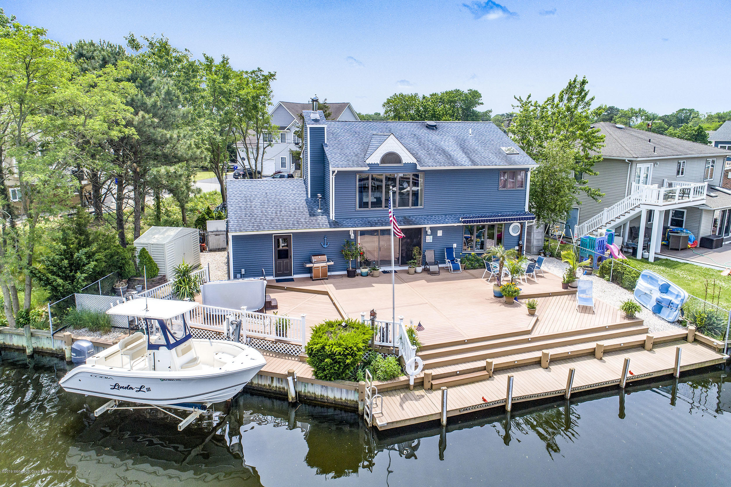 Boater's Paradise!! MOTIVATED SELLER! Protected within the lagoon, but a straight shot out to the bay. This 4BR, 3Ba home is  perfect for year-round shore living. Large open floor plan with stunning lagoon views. 2nd floor MBR must be seen to be believed.  Expansive Trex deck built for an entertainer's dream.  Winter blues, not a problem. Hop into your 6 person hot tub and enjoy the good life.