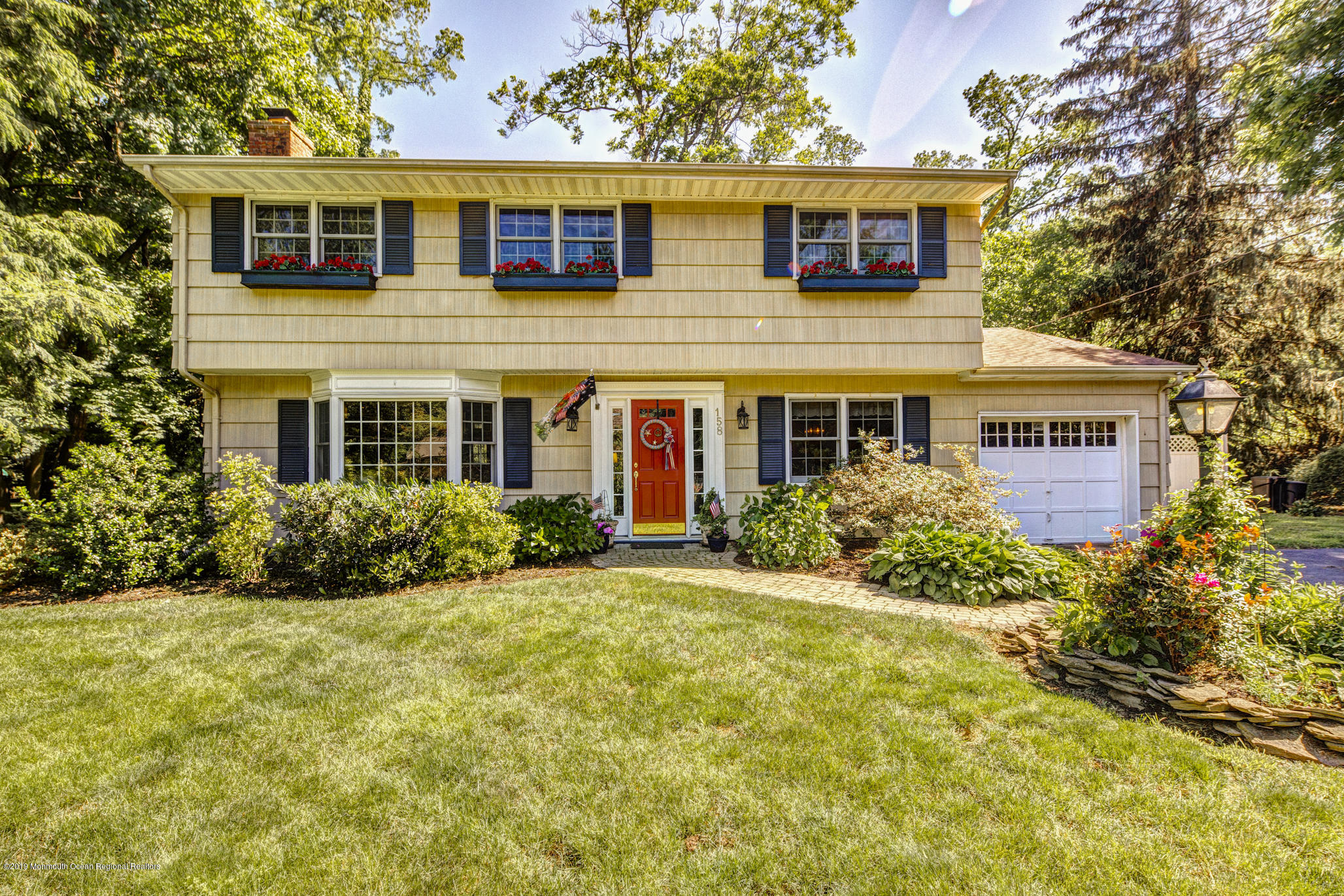 Little Silver Gem...Short distance to the NYC train and a quick trip to the beach! Wide-planked HW floors, custom millwork and built-in cabinetry throughout, make this 4 BR Colonial a MUST-SEE! Sunlight streams through the LR's large bay window, illuminating the brick fireplace surrounded by custom shelving. French doors create a cozy environment. Spacious eat-in kitchen w/copious cabinets, recessed lighting, marble counters, unique backsplash and SS appl. Sliding doors open to a large private, tree-lined backyard & Koi pond. Take in the view of the park-like property from the brightly lit family room with 20' ceilings. The bathroom includes wainscoting, Jacuzzi tub and radiant heat floors! Move right in to experience LS excellent schools, small-town feel and strong sense of community.