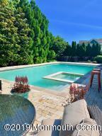 Huge pool, expansive lot.