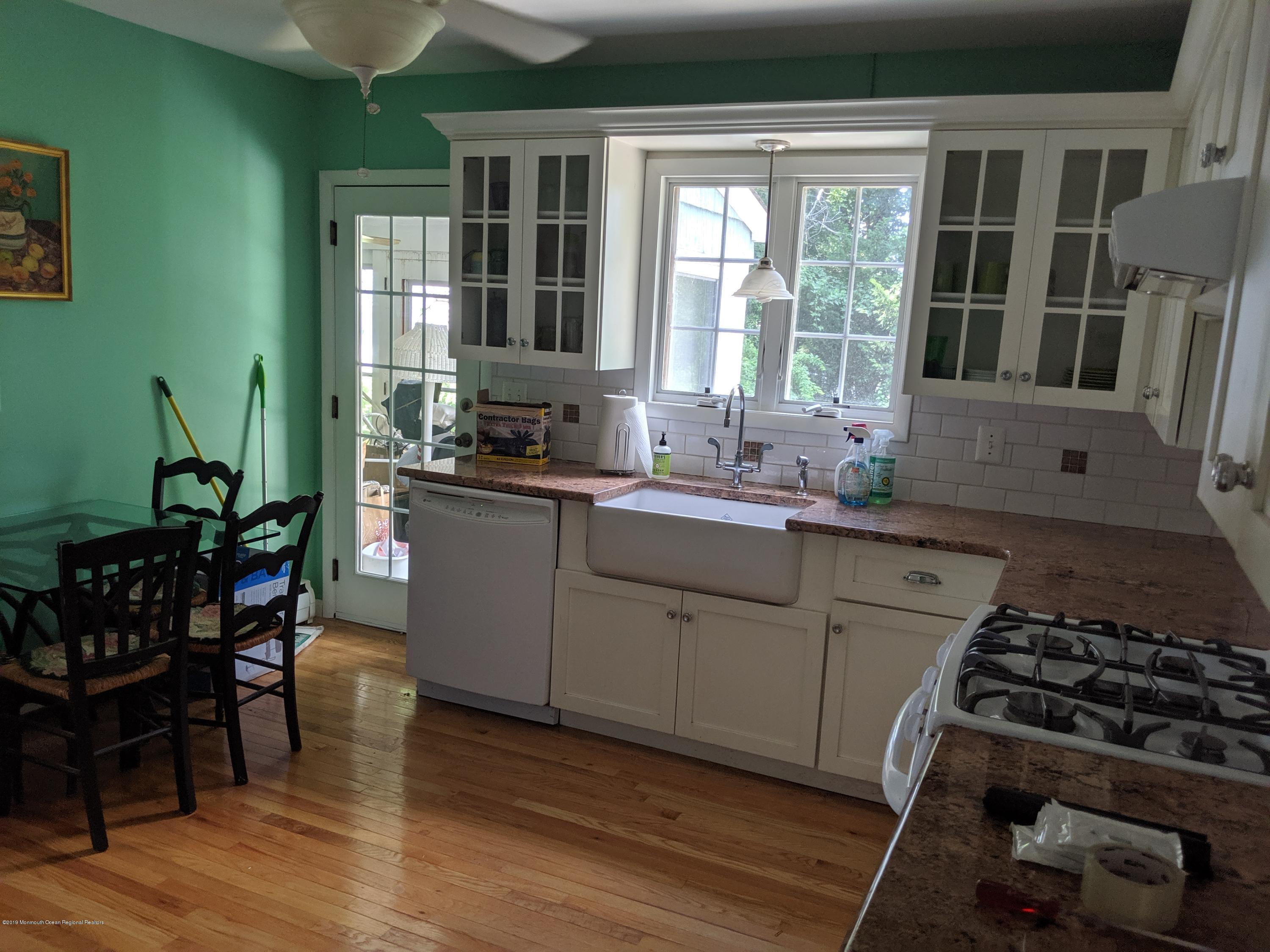 Awesome location very close to downtown Red Bank!  Huge, 75 x 150 lot!  Needs updating on outside, inside is pretty good.. All hardwood floors thoughout.. updated kitchen and bath..  2 br up, 2 down.. 3 season room off back.. as-is sale.. basement.. ceiling fans.. hwbb heat.almost 2000 sf of living space..