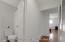Hallway with storage closet