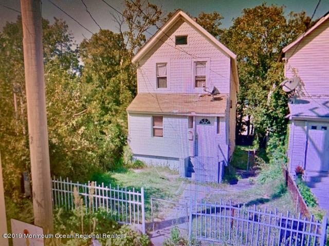 Three Bedroom 2 bath in need of rehab and some TLC.. Currently tenant occupied month to month but can be delivered vacant.. Great handyman special in revitalizing area..