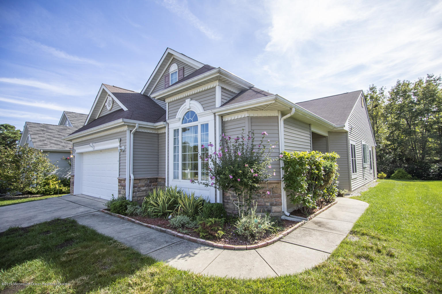 NEW Wood floors throughout. Home backs up to a lovely wooded area for added privacy. Must see. Schedule your appointment today.55+ Adult Community w/ many amenities; some of which are Bocci courts, Tennis courts, Indoor/Outdoor pools, Billiards room, etc.