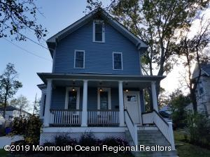 Beautiful historic home with covered open air rocking chair front porch.
