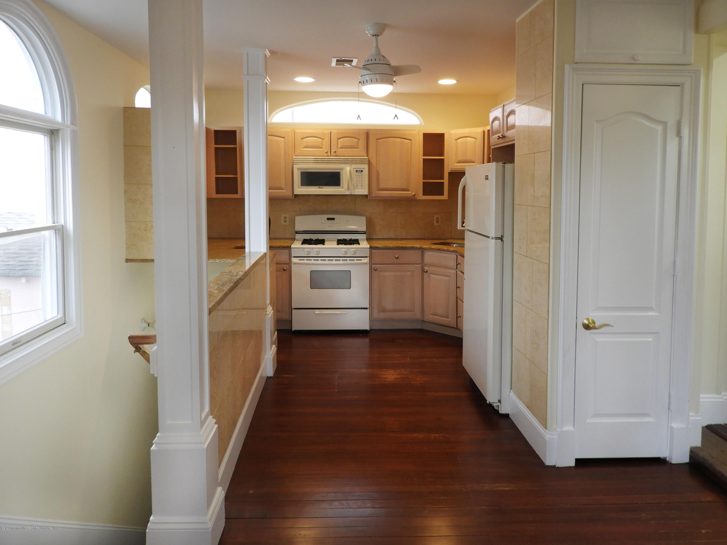 Freshly renovated 2 bedroom apartment with Lake views and offstreet parking for one car. Laundry on premises. Use of spacious backyard. Kitchen with Granite Counters and newer appliances, microwave and dishwasher to be replaced. Plenty of closet space. Separate private entrance. one small pet considered. Walk to the beach and Asbury nightlife.  Credit check required, call Mark at 646-298-4362 for easy showing.