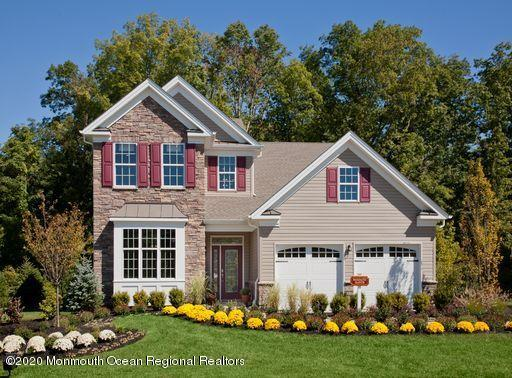 This quality built 2-story Hammond Manor Quick Delivery Home is Move-in Ready! A premium densely wooded interior home site sets this home apart in a big way. This home features a spacious 2-story expanded Family room, formal dining room and a magnificent master suite with tray ceiling & walk-in closet. With 2 additional bedrooms and baths and a study ILO Living room this home has it all! Structural and Design Studio selections valued at over $100,000 are included in this exceptional price!Sea Breeze at Lacey offers resort style living with an award winning 13,000 sf clubhouse with 2 exercise rooms, tennis, bocce, card rooms, art room, large heated outdoor pool and spa and so much more! Call today to find out more about making this home your own!