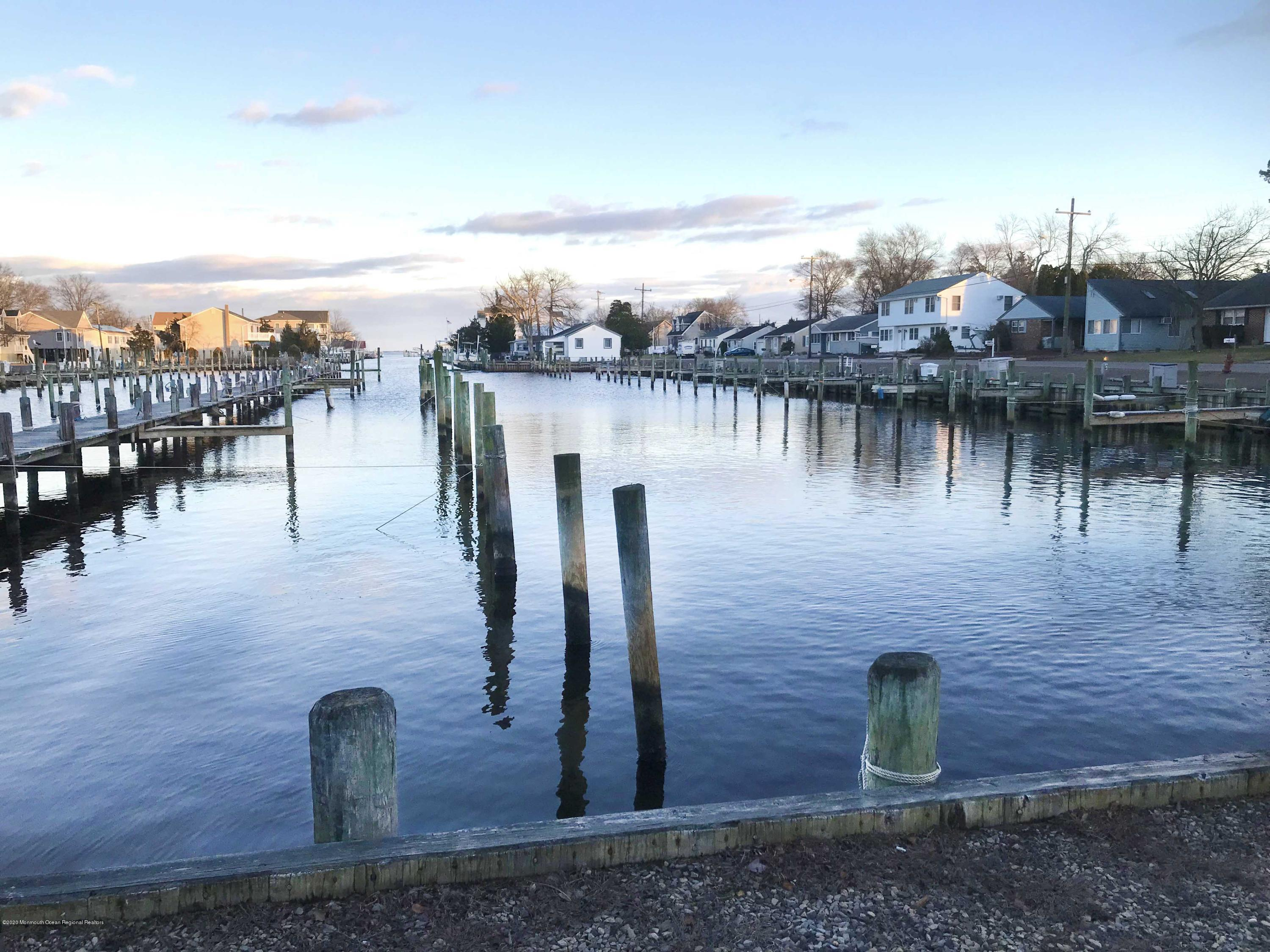 Live the dream with this opportunity to own your own marina! Located on the protected South Harbor Lagoon in Waretown, NJ. with direct access to the Barnegat Bay and the intracoastal waterway. Located across the bay from the Barnegat Inlet, less than a 15 minute boat ride from the Atlantic Ocean.130+ slips for boats up to 50 feet, with direct parking behind most boat slips, offering your boaters convenient, quiet and uninterrupted use of their boat. Mens/womens restrooms, picnic area, bbq grills, trash disposal, 30-amp metered electric and dockside water. Perfect location for skiers, cruisers or fishermen. Neighboring marina is full service with fuel and repair. Possible Seller financing available.