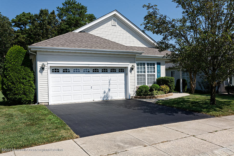 The''Nantucket'' is the largest Model available in Heritage Bay.  Newer-Roof-Heat & A/C.  A great home for entertaining. Situated on a very private setting. Newer Kitchen Stainless Appliances-Granite Counters 42'' Cabinets.  The Dining Room could easily be converted to a 3rd bedroom and still have plenty of space.  The Master Bedroom has a large WIC and private Master Bath /Double sinks -Granite Counter.  Relax in the All Seasons Room while watching nature or a good book.  Painted Neutral Colors/Gas Line inside for a Fireplace. Driveway recently re-sealed.  So many possibilities.  Visit soon!